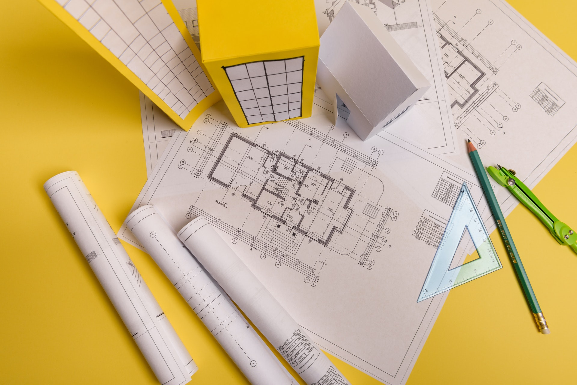 Yellow architecture plans with pencil